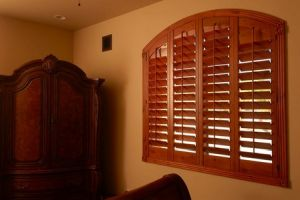arched wood shutters